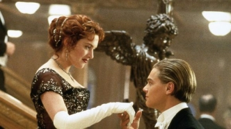 Jack Dawson (Leonardo DiCaprio) greets Rose DeWitt Bukater (Kate Winslet) at the bottom of a staircase in 'Titanic.' (Photo: Merie Weismiller Wallace, Paramount Pictures/20th Century Fox)